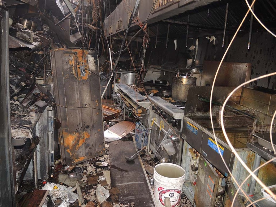 badly damaged space with burn marks visible