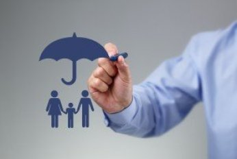 Businessman hand drawing an umbrella above a family concept for