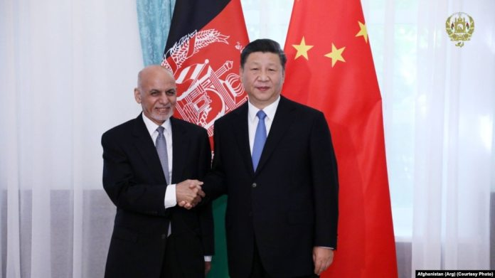 FILE: Afghan President Ashraf Ghani with his Chinese counterpart Xi Jinping in Kyrgyzstan in June 2019.