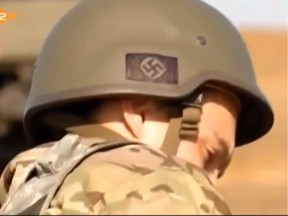 A news broadcast by German ZDF station on September 8 showed soldiers of the Ukraine Azov Battalion in Mariupol with nazi symbols on their helmets0922 weapons