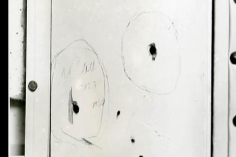 [Image: marked-bullet-holes-in-door-frame.jpeg?r...C306&ssl=1]