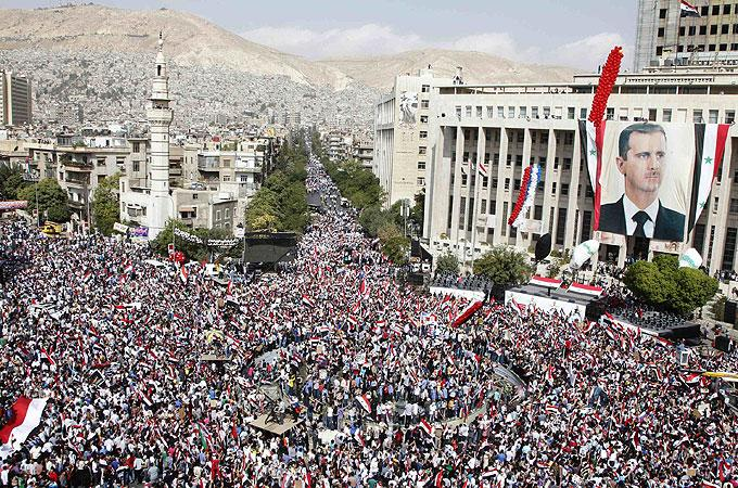 Thousands rally in support of Syria's Assad | China News | Al Jazeera