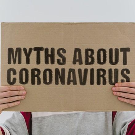 "Handmade sign that says ""Myths About Coronavirus."""