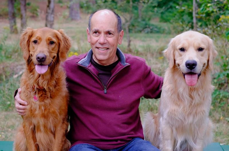 Eric Schuman with two dogs