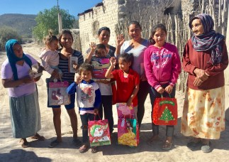 Giving out Christmas gift bags to children in 2016