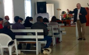 preaching at a church in a neighboring state, after training them in evangelism and discipleship