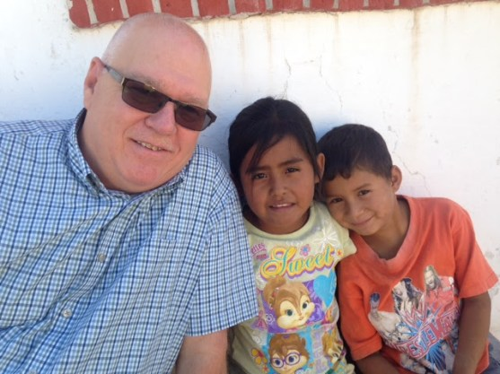 Phil with two children at VBS at the ranch