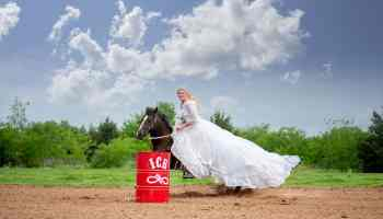 Mom's wedding dress. This Bride Is Running Barrels In Her Mom's Wedding Dress bridal running barrels cowgirl magazine