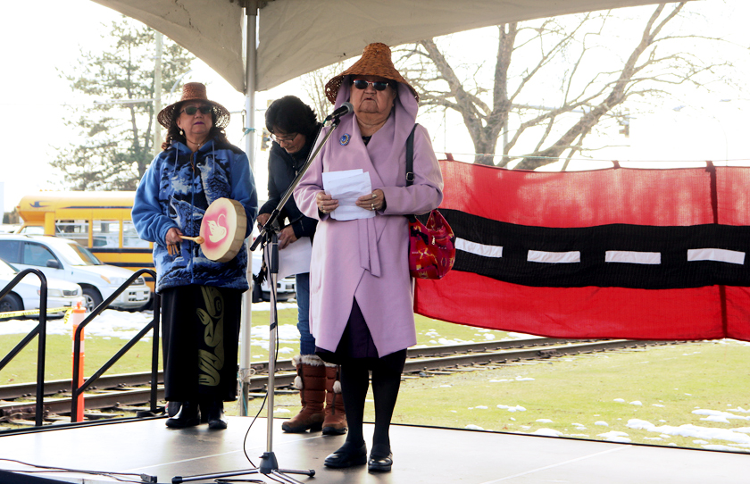 Maureen Tommy, and Debra Toporowski stand with Dora Wilson for the welcome and prayer