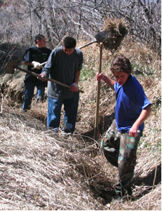 Acequia cleaning prior to running the first water of the season