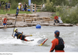 Miles Harvey of Salida takes  a spill off his standup paddle board into the Uncompahgre River during FUNC fest on Saturday
