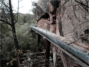 An acequia along the Las Trampas in northern New Mexico is suspended on a trestle. (Eddie Moore/Albuquerque Journal)