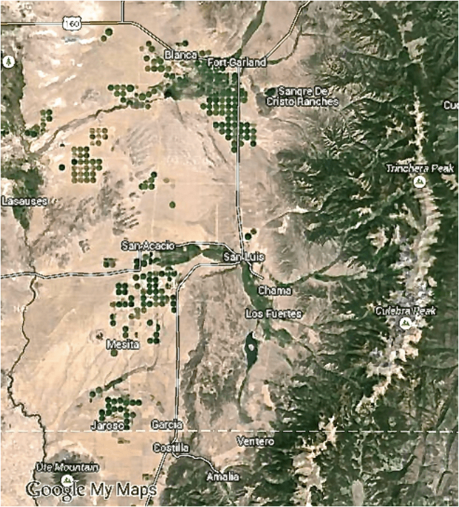 Center-Pivot and Acequia Farms. The green belts along the Río Culebra and tributaries in San Acacio, San Luis, Chama, Los Fuertes and other unmarked villages are the principal acequia farm bottomlands in Costilla County. The  center-pivot circles are concentrated in the Blanca-Ft. Garland vicinity to the N and the Mesita-Jaroso vicinity due W and SW of the acequia bottomlands.  Source: Google Maps (screenshot).