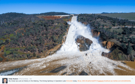 View of both spillways from just above the Feather River. Note the location of the catastrophic spillway failure center top of photo and the new channel to the right. Emergency spillway can be seen left of the failed spillway with the discharge coursing through the hillside to the left. Photo credit @ProComKelly.