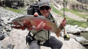 Kevin Terry, a project coordinator for Colorado Trout Unlimited, holds up a Rio Grande cutthroat trout at Upper Sand Creek Lake.