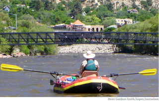 A rafter on the Colorado River looking upstream toward Glenwood Springs. The Middle Colorado Watershed Council has recently received a $104,000 state grant for its $415,000 integrated water management plan for the Colorado River between Dotsero and DeBeque. It will look at recreational and environmental flows, as well as consumptive use of water by ag and cities. Photo credit: Brent Gardner-Smith