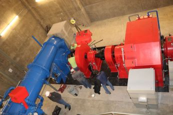 Workers prepare a turbine and generator at the James W. Broderick Hydroelectric Power Facility at Pueblo Dam shortly before it began producing electricity this week. Photo credit: The Southeastern Colorado Water Conservancy District