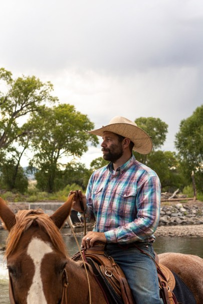 Kyler Brown rides along the Rio Grande River, where headgates divert water into irrigation canals. Coming up with a plan to reduce water use is the easy part, he says. Changing peoples' behavior is trickier. Photo credit: Luna Anna Archey/High Country News