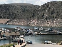 A longer walk from the dock to the water is in store for boaters at the Elk Creek marina, Blue Mesa Reservoir. Blue Mesa is being drawn down to feed critically low Lake Powell, as continued dry weather and rising demand deplete the Colorado River. (Courtesy photo/National Park Service) August 2021 via the Montrose Daily Press