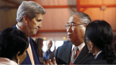 U.S. Secretary of State John F. Kerry, left, talks with China's special representative on climate change Xie Zhenhua prior to the opening of the COP21 conference in Le Bourget, France on Saturday. (Francois Mori / AP)
