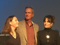 Travis Smith with daughter Helen (L) and wife Maureen (R).