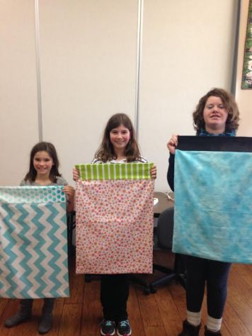 The girls with their cousin, Sarah, after a successful sewing class