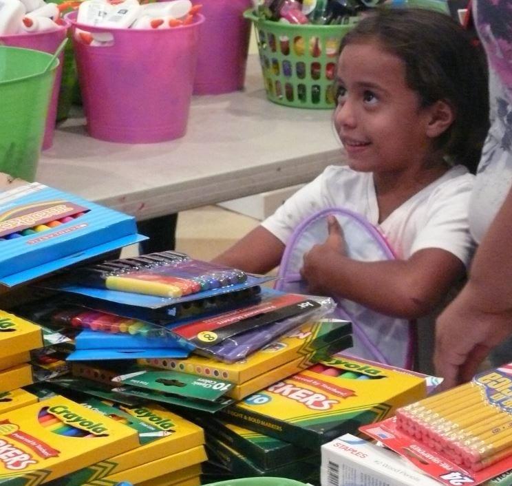 LIttle Girl Receives School Supplies