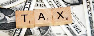 tax scrabble tiles dollars
