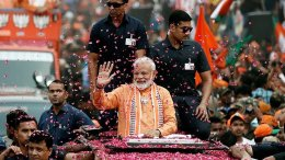 Modi is being greeted by Flowers in Varanasi