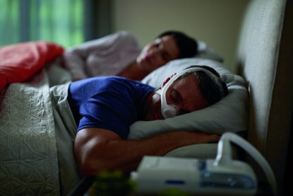 Man Sleeping with CPAP Mask - cpapRX