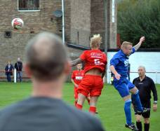 Bulldogs manager Dean Morris looks on as Thomas Davies challenges for the ball.