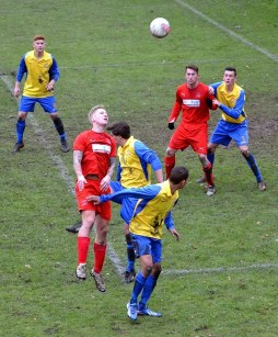 Thomas Davies was solid once again in defence. Here he jumps to head the ball at a corner kick.