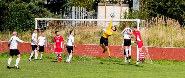 Ton Pentre force the Goytre goalkeeper to tip the ball over the crossbar.