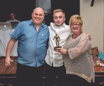 Dan Kinsey receives his Club Player of the Year award from Councillor Maureen Weaver.