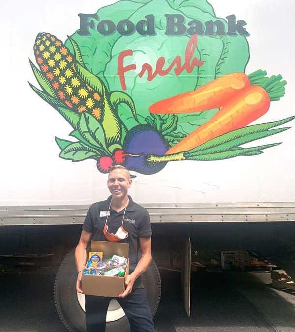 man food box vegetable sign volunteer