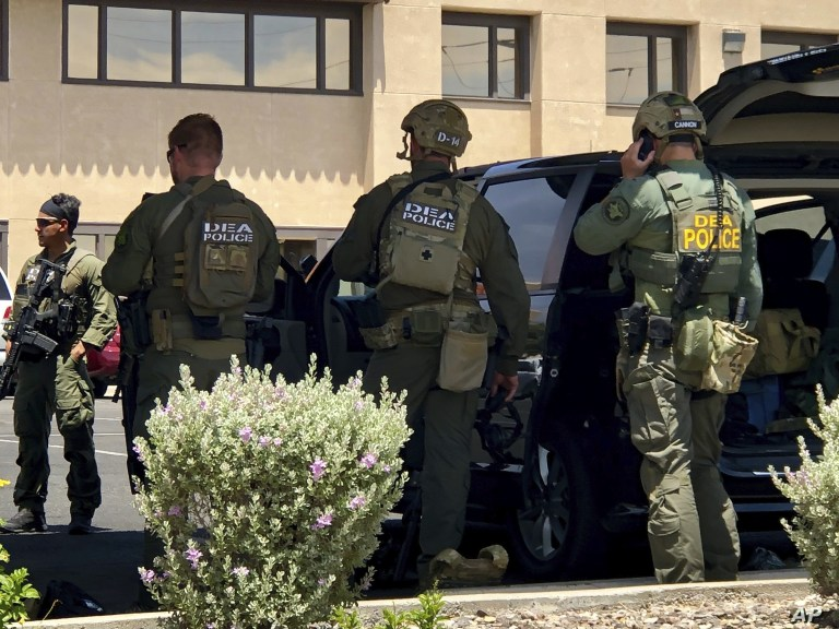 Law enforcement work the scene of a shooting at a shopping mall in El Paso, Texas, on Saturday, Aug. 3, 2019.