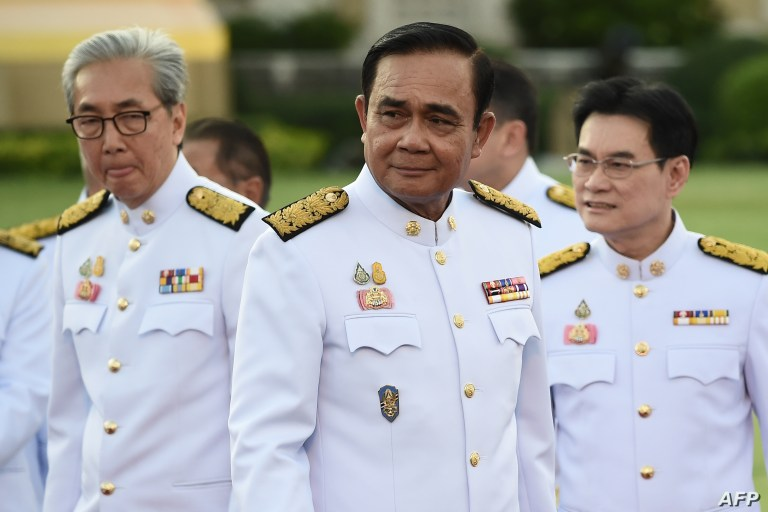 Thailand's Prime Minister Prayuth Chan-ocha, center, arrives for a photo opportunity with members of the new Thai cabinet at Government House in Bangkok, July 16, 2019.