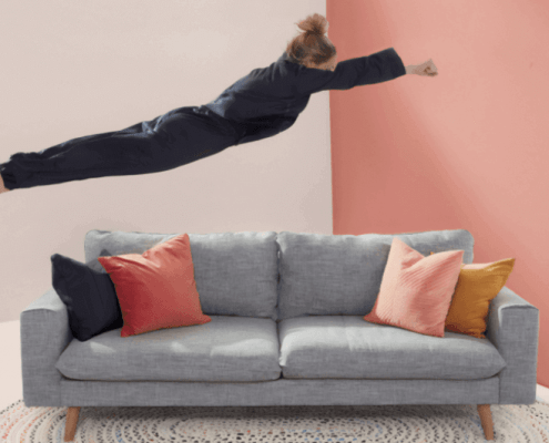woman jumping onto couch