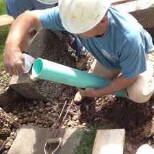 plumber laying underground pipe