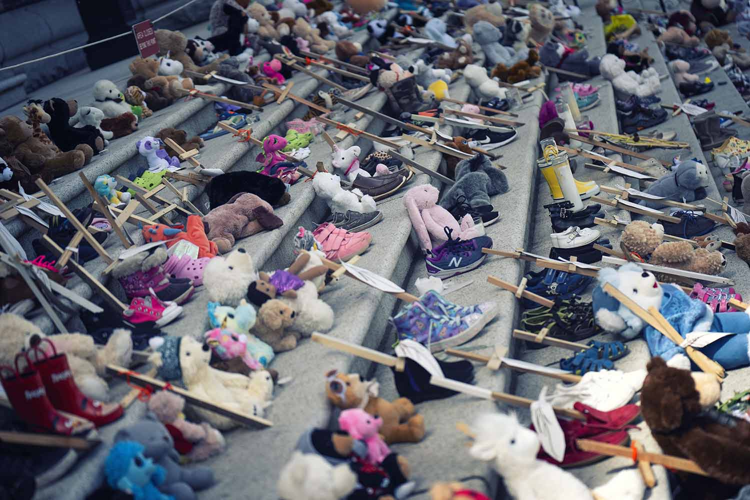 215 pairs of shoes honor lives lost at Every Child Matters rally