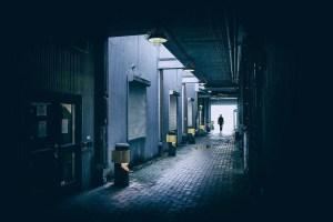 Man walking down alley