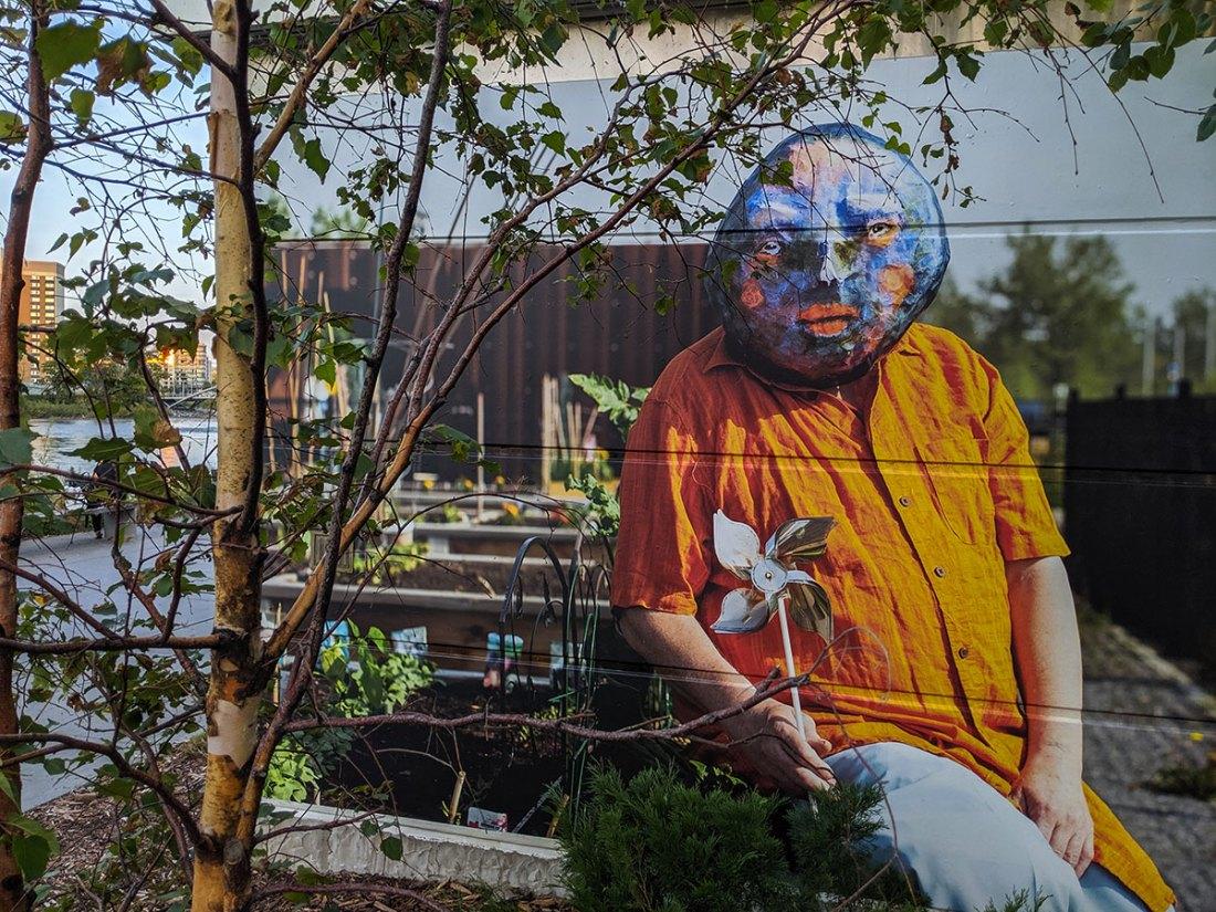 East Village Mask Mural orange shirt pinwheel