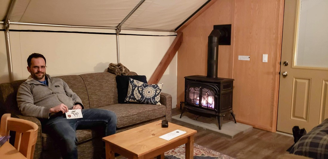 Mount Engadine Lodge glamping tent pull out couch and propane gas fire place