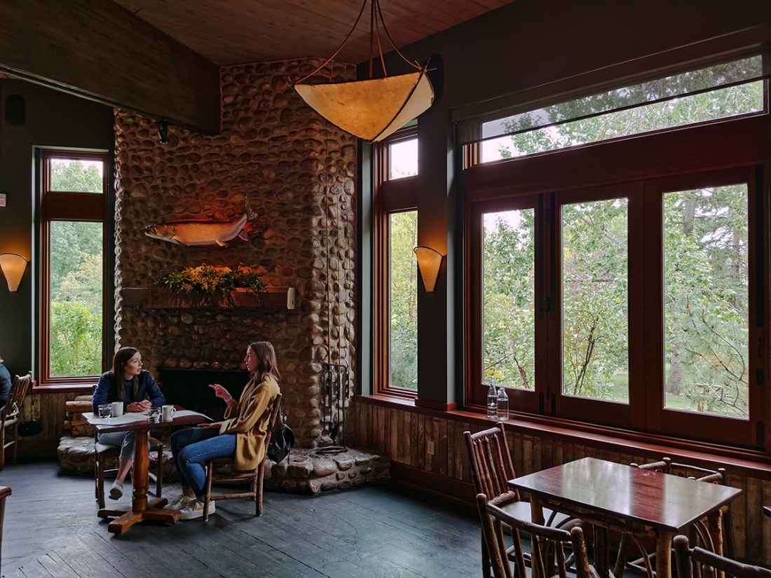 River Café At Prince's Island Park Stone fireplace with rustic interior