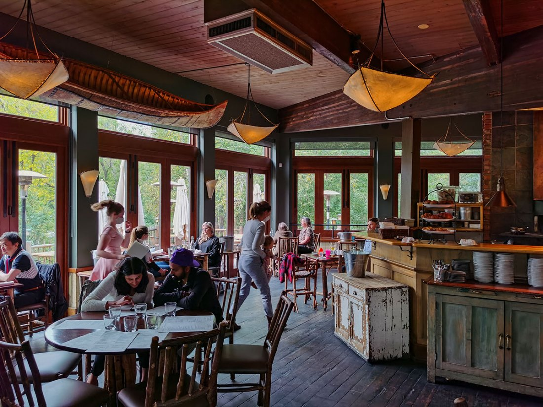 River Café at Prince's Island Park tables with glass windows overlooking patio
