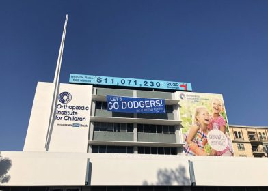 """""""Go Dodgers!"""" vinyl banner displayed on a balcony."""
