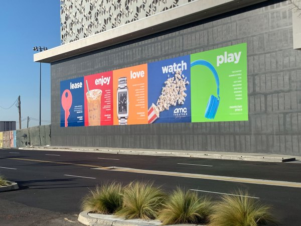 Outdoor wall graphics increase foot traffic.