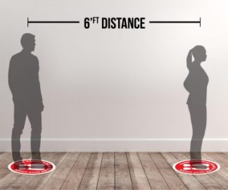 Social distancing signs provide an easy six-feet reference.