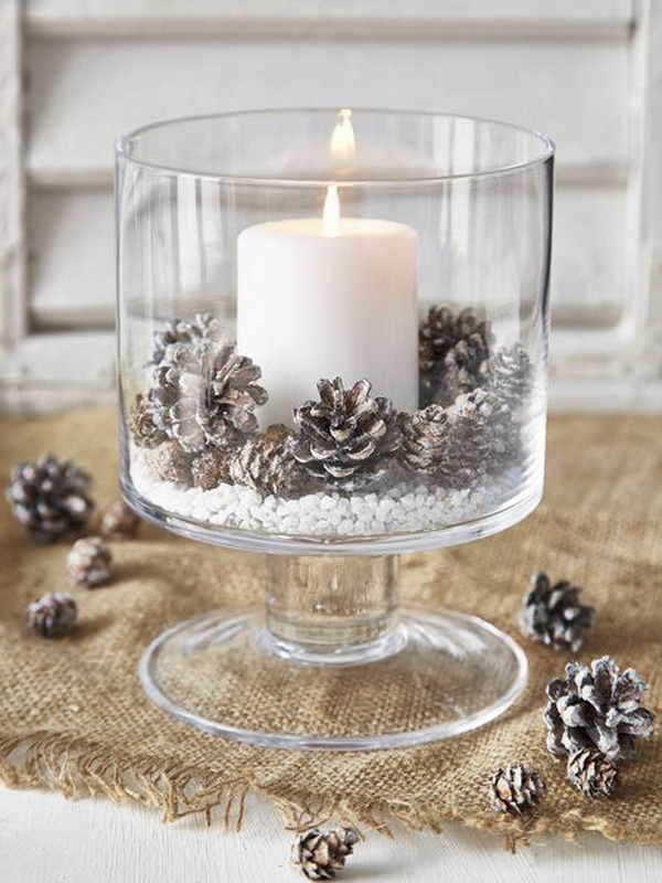 Rustic Luminary. Light up your table this Christmas with candle! Place it in a clear glass and decorate with painted pinecone.