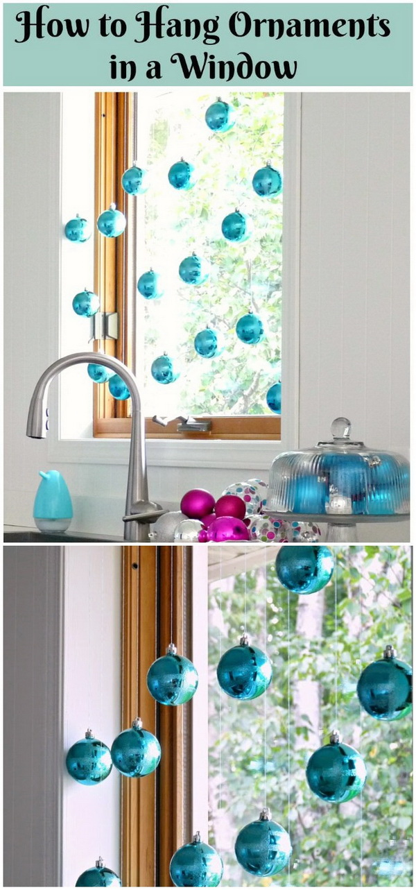 hang christmas ball ornaments in front of a window small window decorations made with christmas ornaments is the perfect addition to christmas dcor via